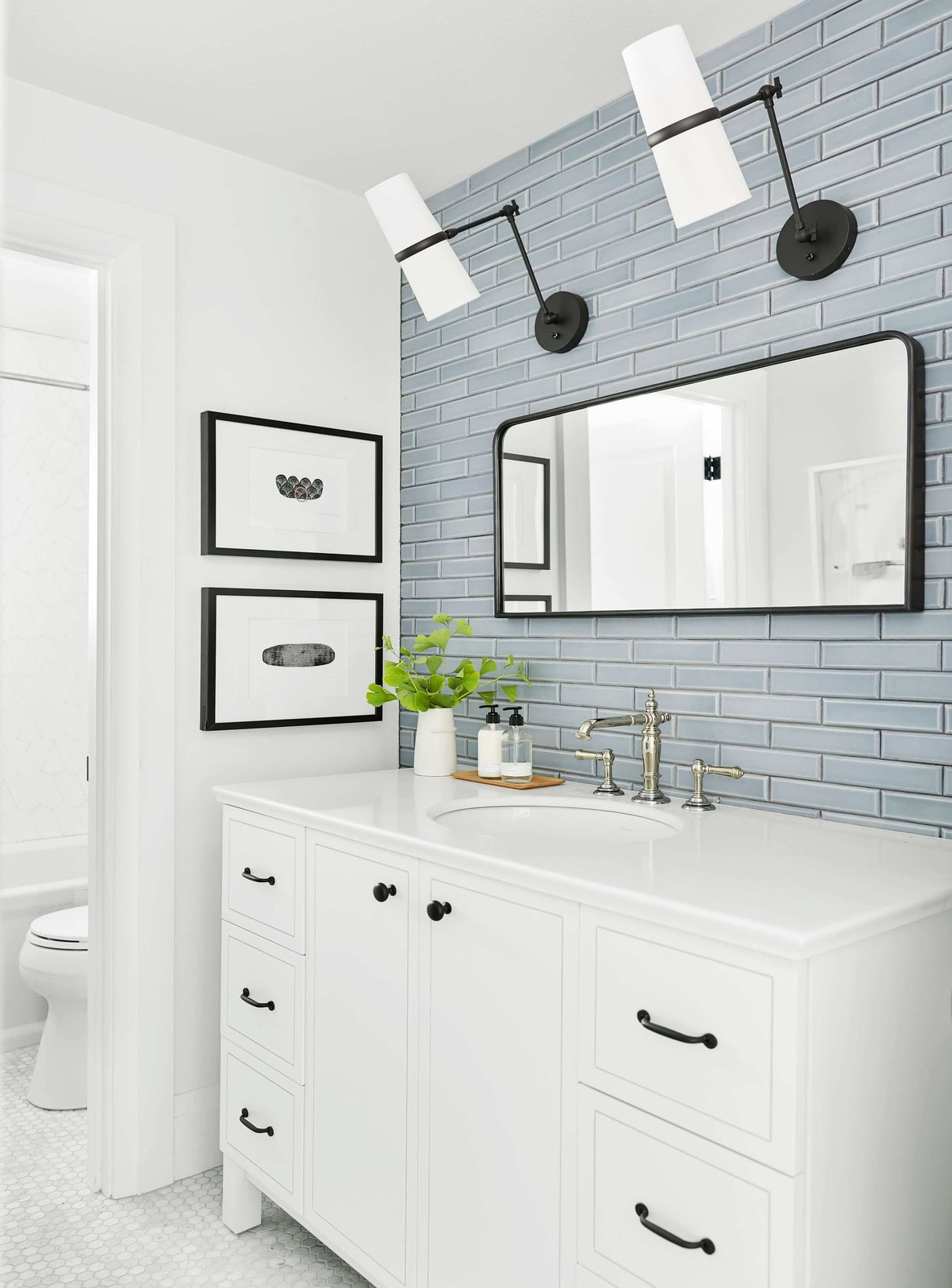Modern farmhouse mixed metal bathroom with a black framed mirror and lighting with a polished nickel sink faucet- Maison de Pax