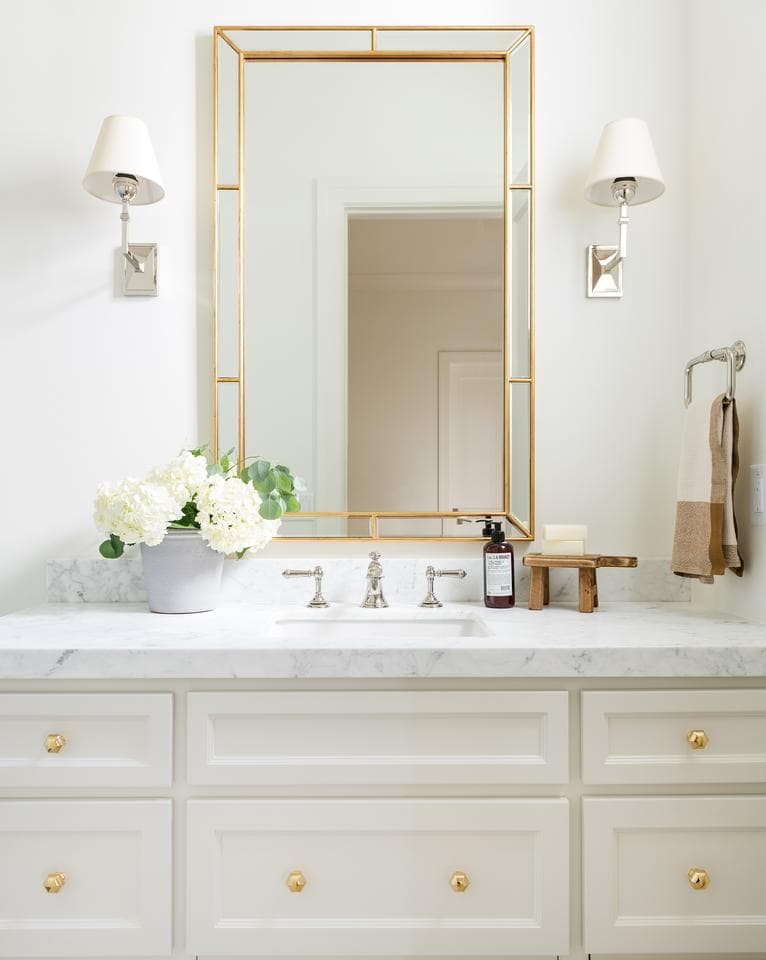 Beige painted bathroom vanity with mixed metal gold hardware and a marble top- Maison de Pax