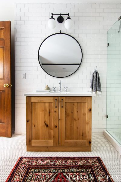 natural wood bathroom vanity with white subway tile backsplash to ceiling | Maison de Pax