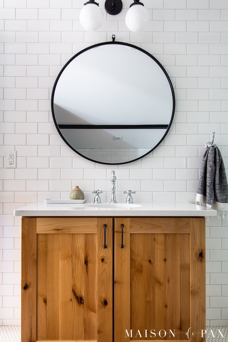 wood vanity with white quartz counter and white subway tile backsplash | Maison de Pax