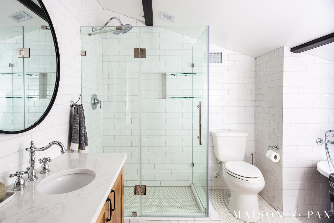 white subway tile walls with frameless shower enclosure | Maison de Pax
