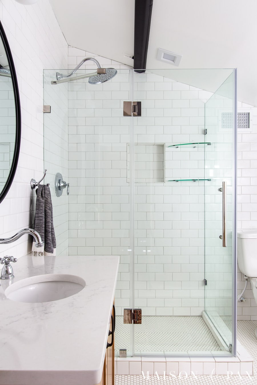frameless shower door for white tile shower with white quartz countertops | Maison de Pax