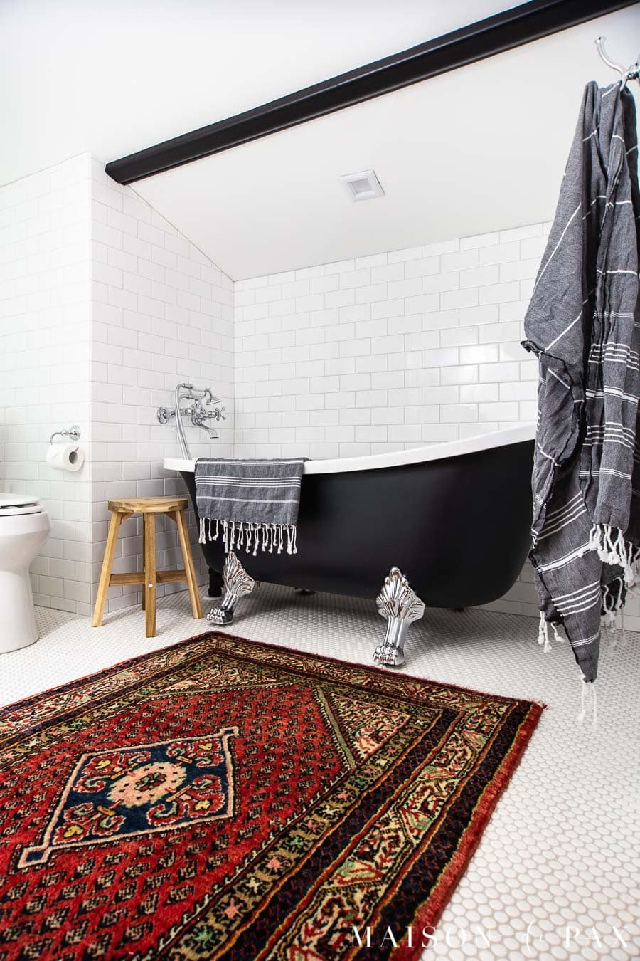 white bathroom with subway tile and black clawfoot tub | Maison de Pax