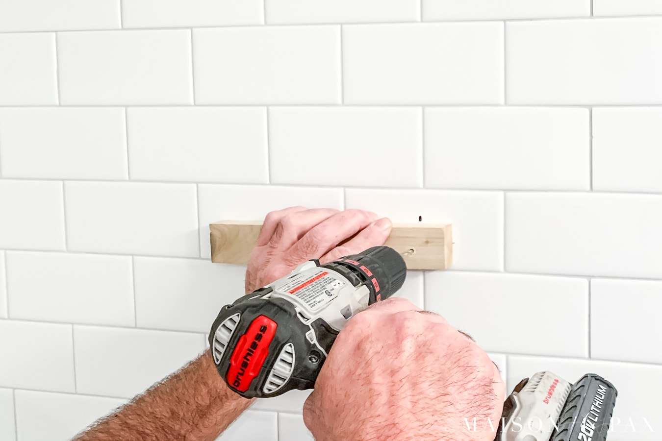 drilling into tile with scrap wood to guide the drill | Maison de Pax