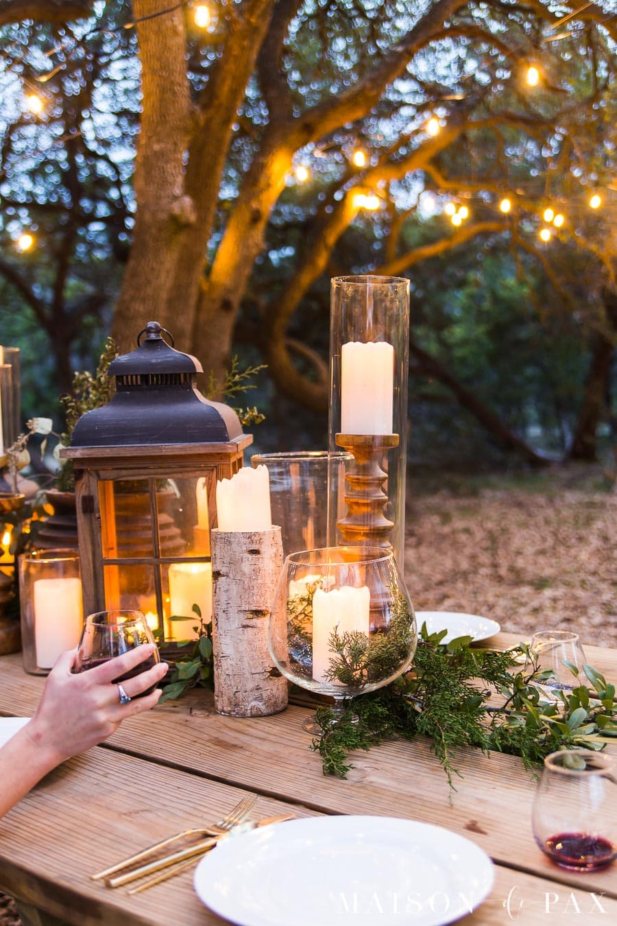 elegant candles and greenery on rustic outdoor dining table | Maison de Pax