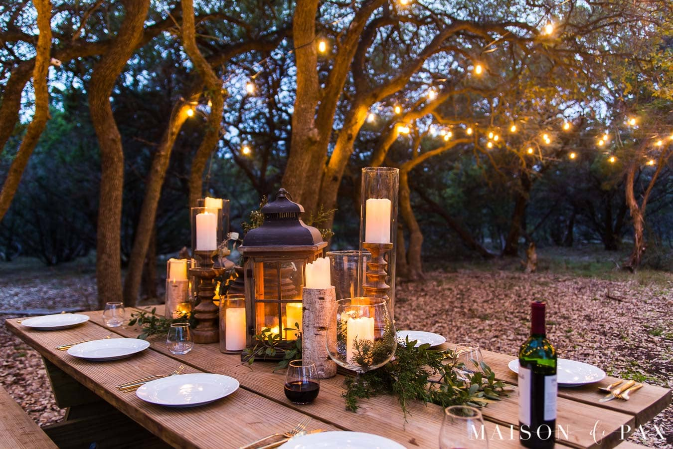 outdoor dining with candles and string lights | Maison de pax