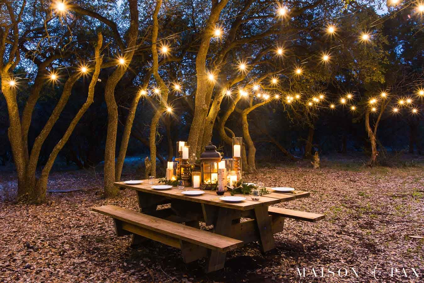 globe string lights over a giant picnic table | maison de pax
