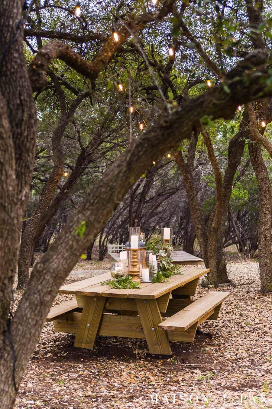 elegant picnic table in arbor | Maison de Pax