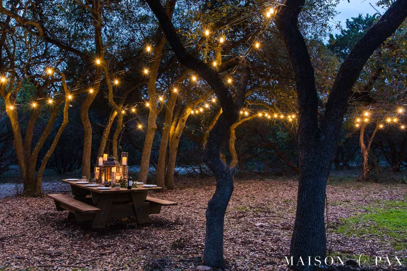 globe lights strung over outdoor patio area | maison de pax