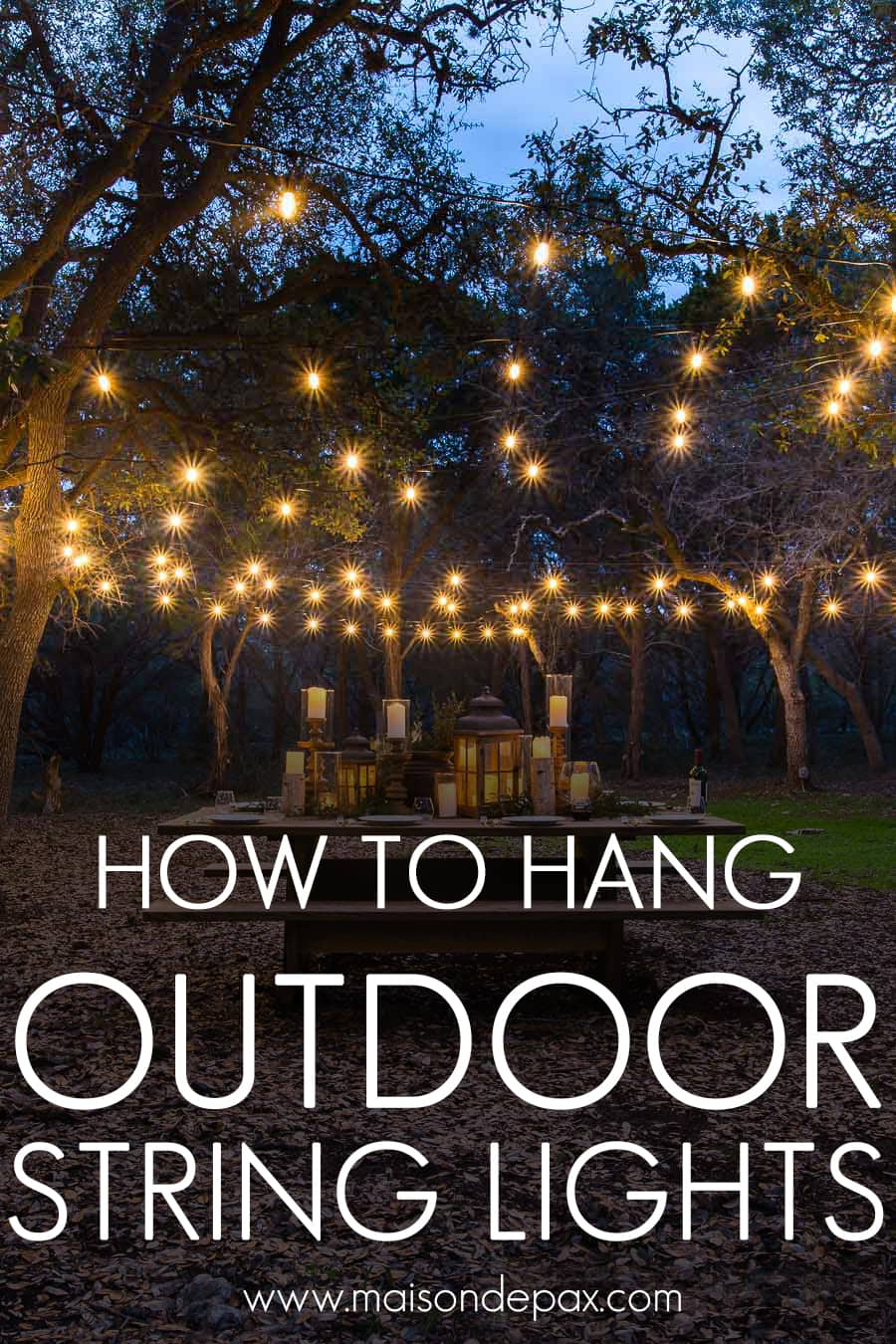 gorgeous globe string lights over a picnic table outdoors | Maison de Pax