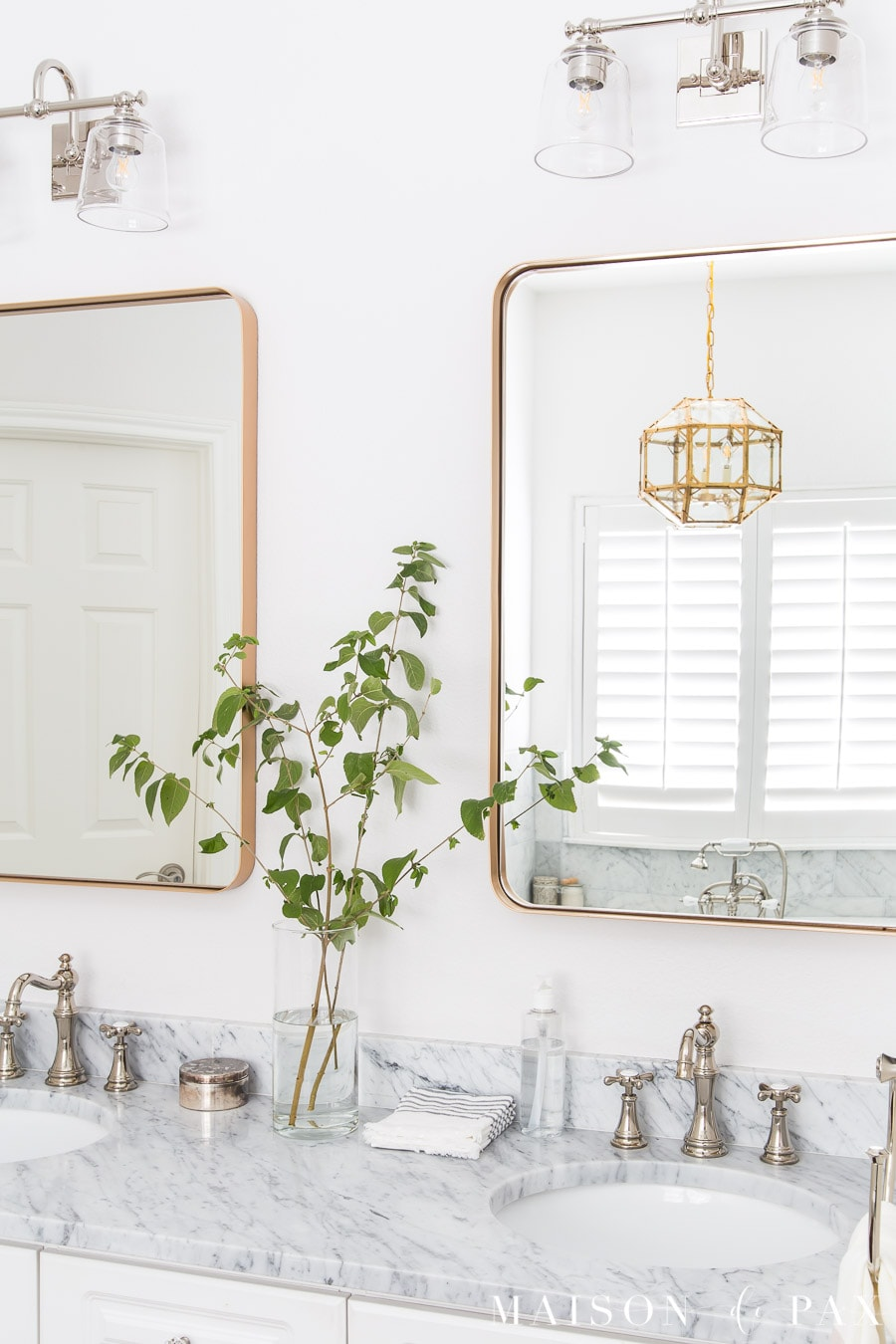 mixed metals in bathroom: gold mirrors with polished nickel faucets | Maison de Pax