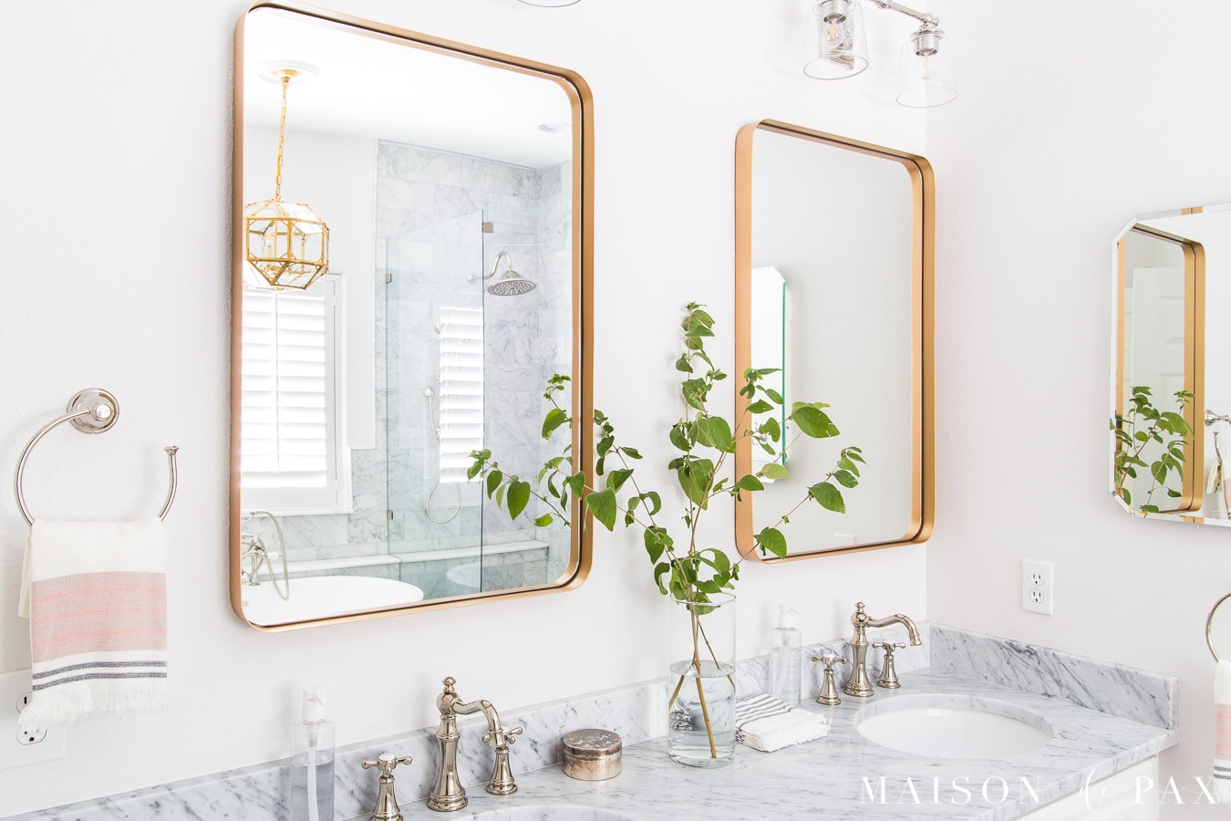 modern gold framed bathroom mirror with marble countertops | Maison de Pax