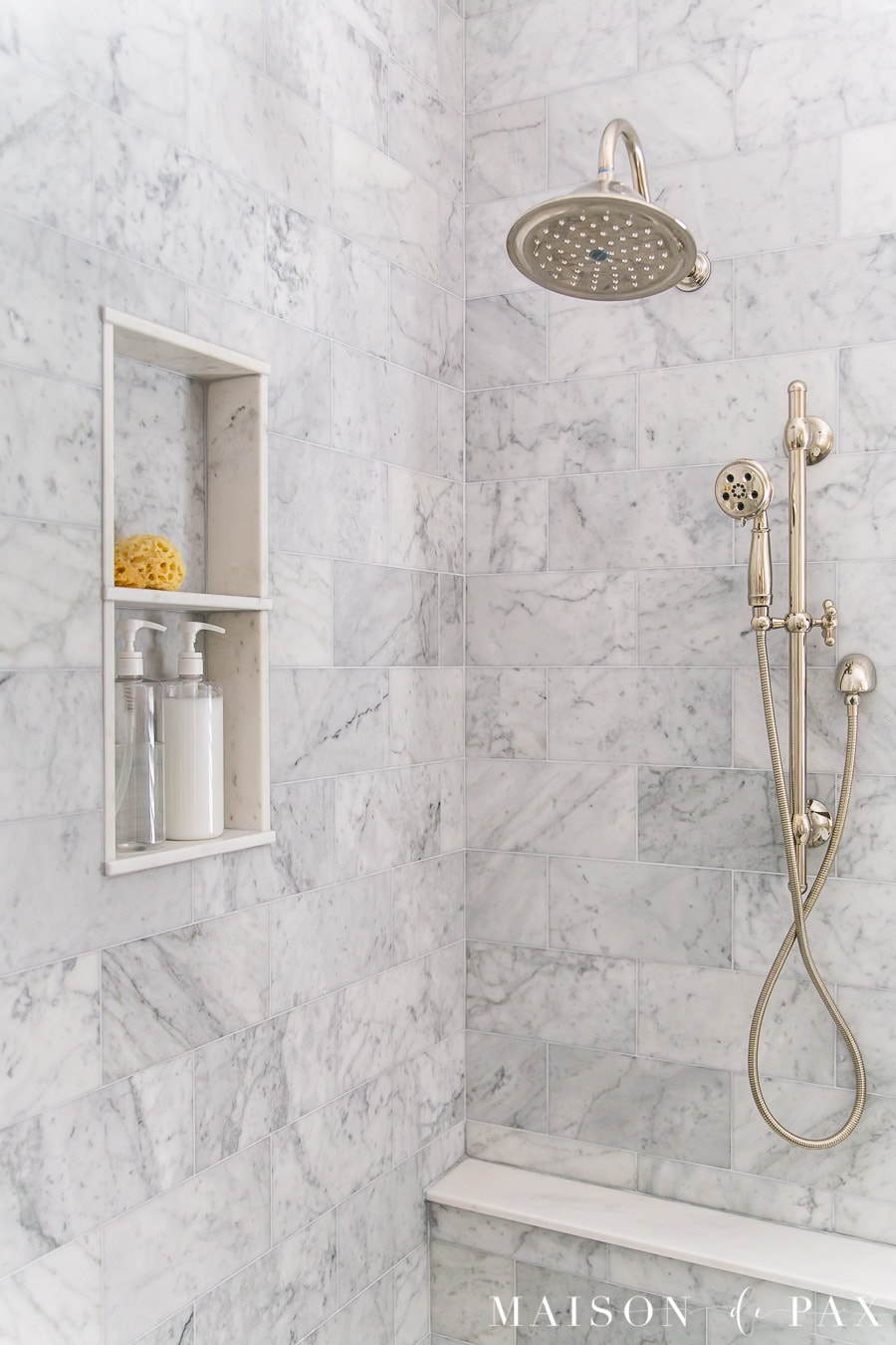 Carrera Marble Tiled Bathroom and shower with a traditional polished nickel shower head- Maison de Pax