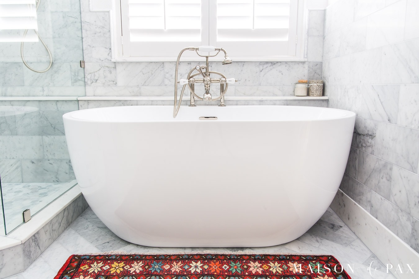 white freestanding tub under window | Maison de Pax