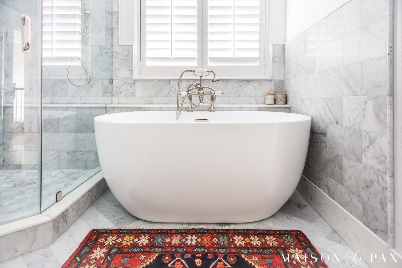 colorful vintage persian rug in front of freestanding tub | Maison de Pax