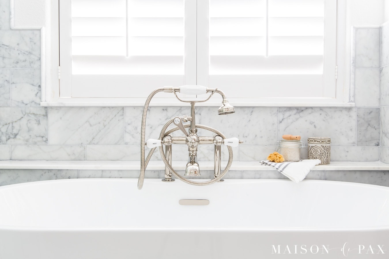 marble tub ledge under window behind freestanding tub | Maison de Pax