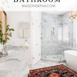 marble bathroom with vintage rug and text overlay: luxurious marble master bathroom | Maison de Pax