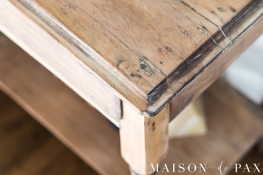 edge of an antique nightstand that has been finished with a stripped, raw wood look- Maison de Pax