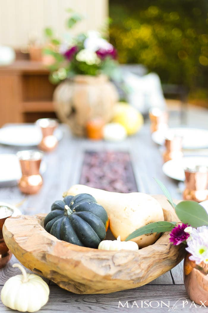 gourds and wooden bowls make a rustic fall table decoration