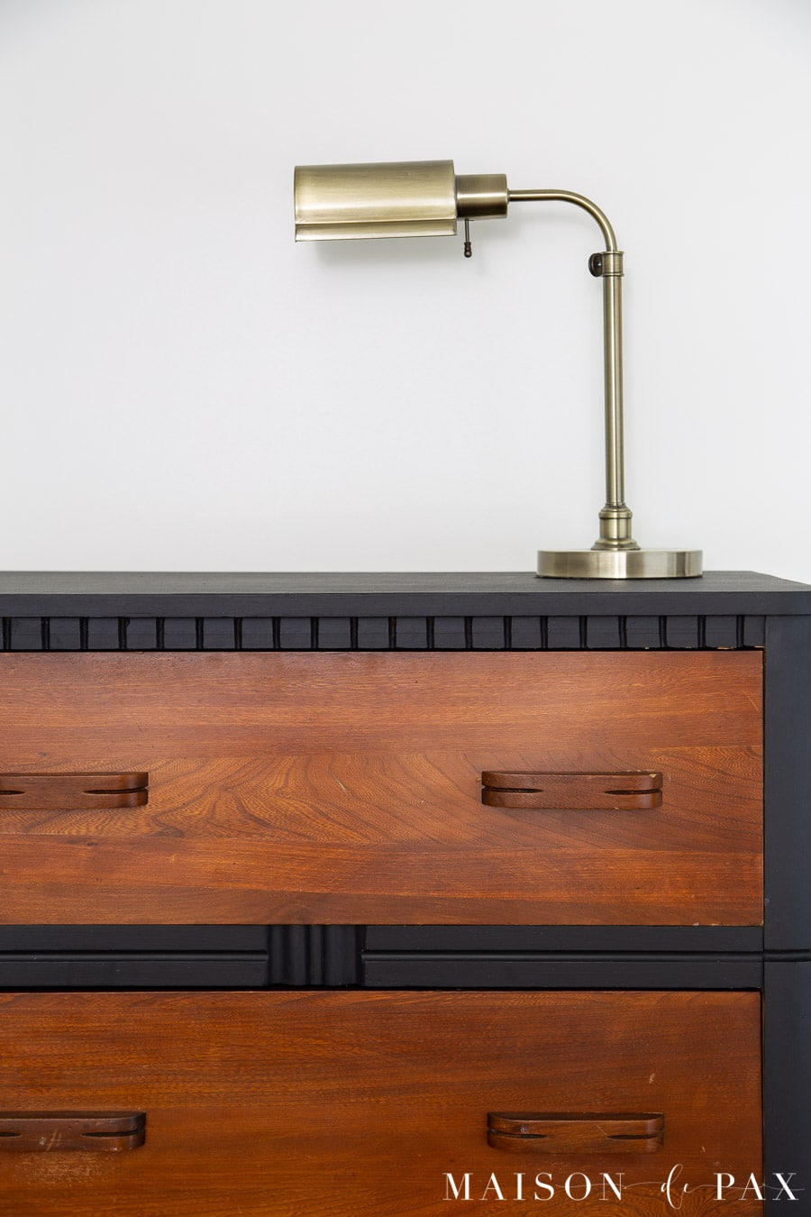 black matte dresser with rich brown wood drawers