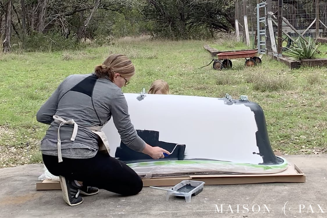 painting the outside of a clawfoot tub with a roller | Maison de Pax