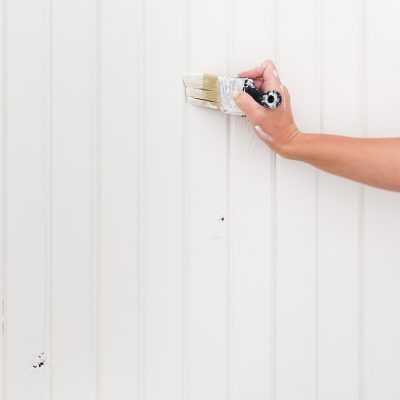 use a small angled brush to paint the grooves on wood paneling | Maison de Pax