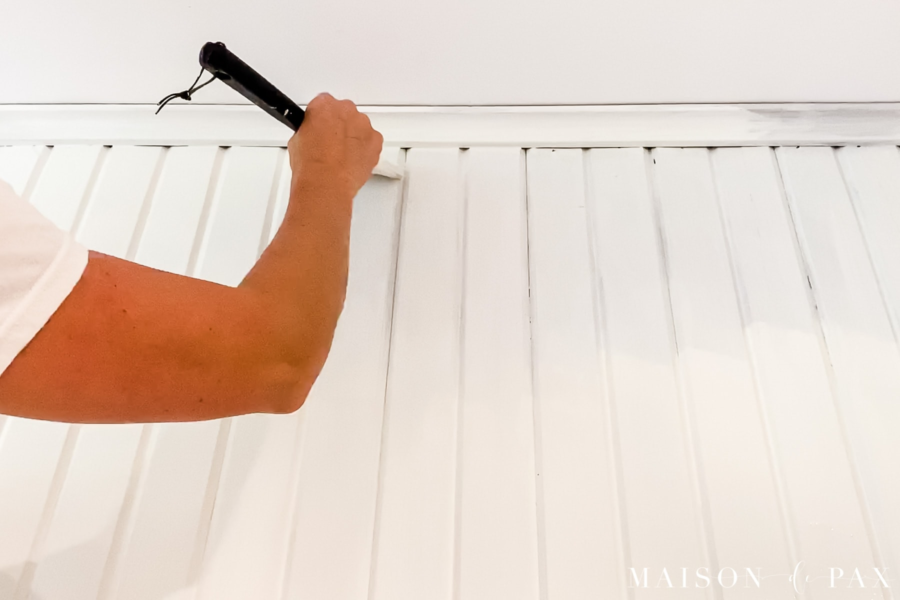 painting wood paneling with a angled brush | Maison de Pax