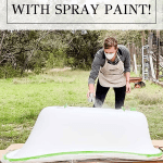 woman spraypainting tub with overlay: paint a clawfoot tub | Maison de Pax