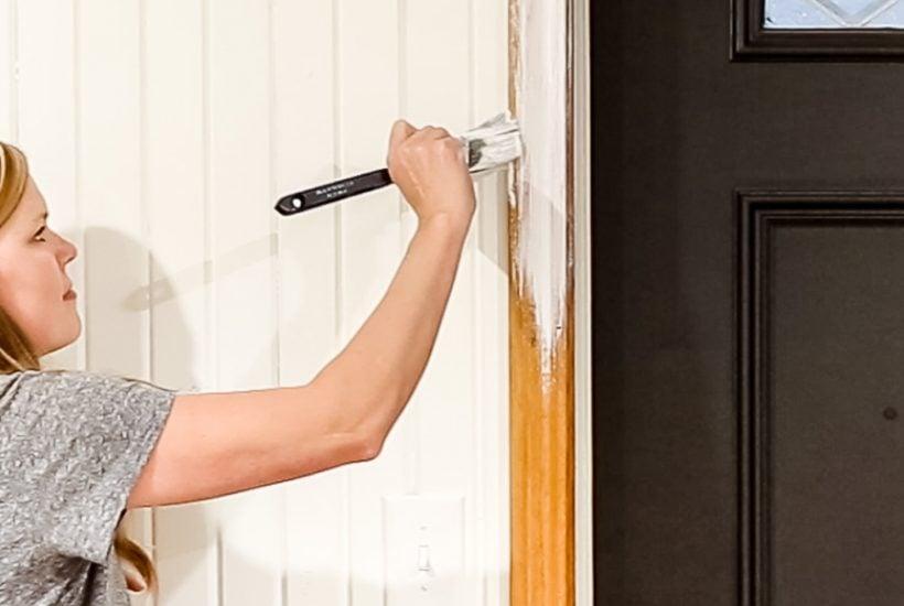 woman painting wood trim white | Maison de Pax