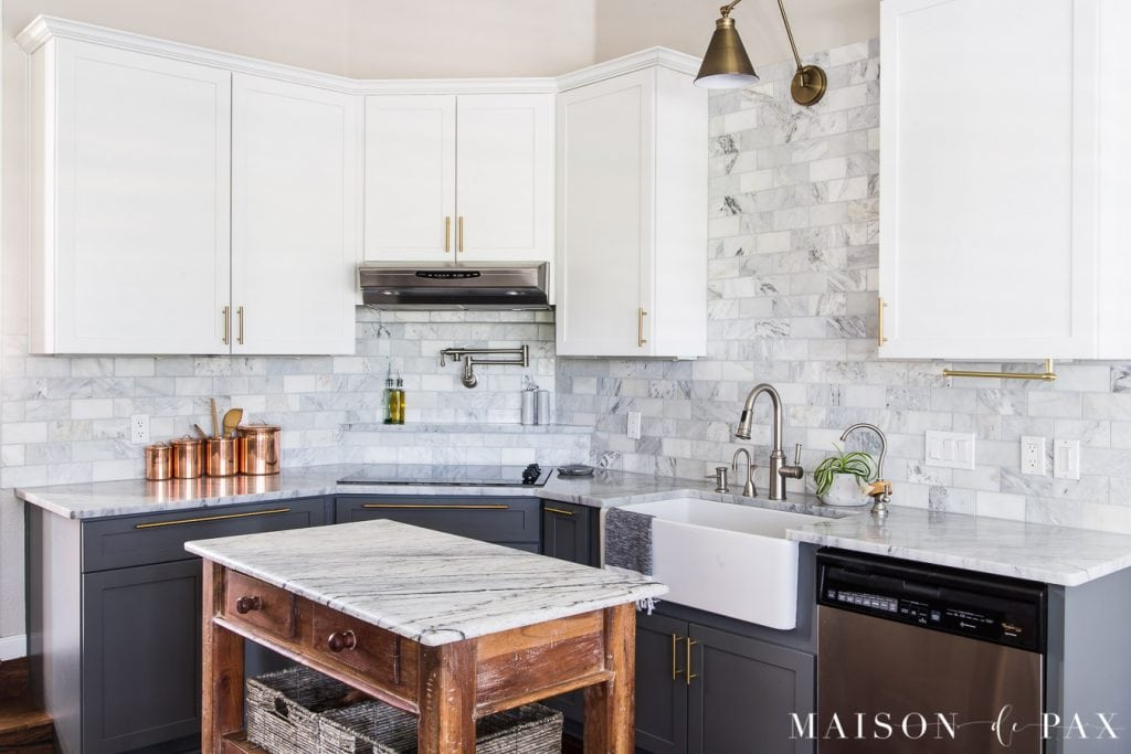 marble kitchen with gray and white cabinets and wood island | Maison de Pax