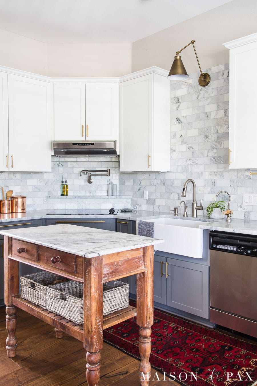 marble kitchen with small wood island | Maison de Pax