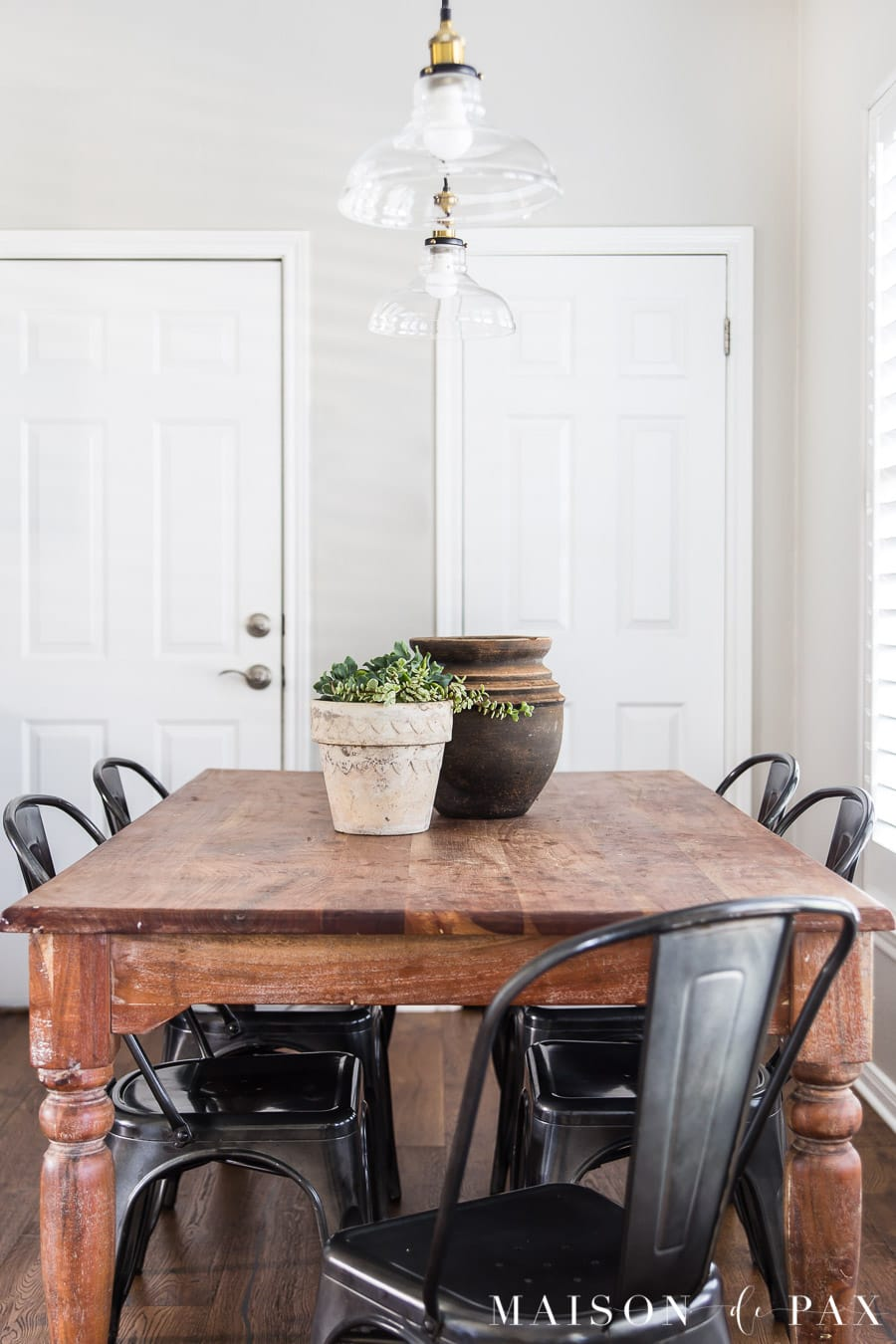 rustic wood dining table with turned legs and metal chairs | Maison de Pax
