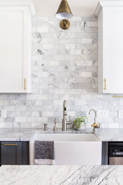 kitchen farmhouse sink with marble counters and honed marble backsplash | Maison de Pax