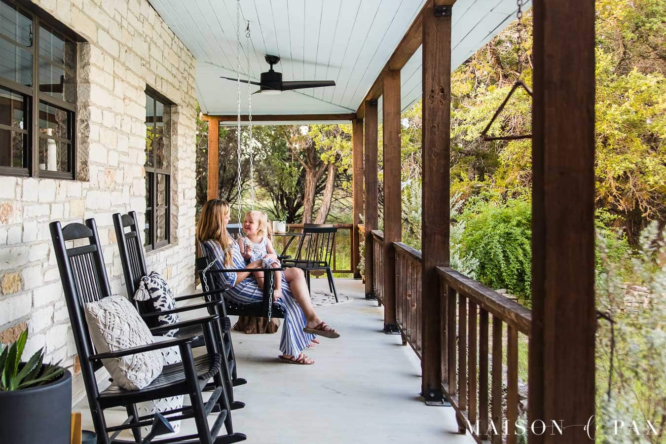 mother and daughter sitting on porch swing | Maison de Pax