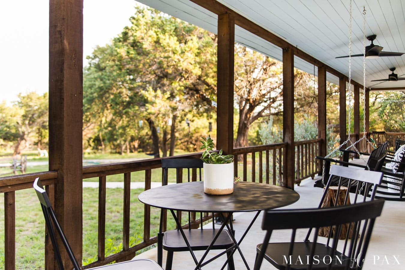 bistro table and metal chairs on front porch | Maison de Pax