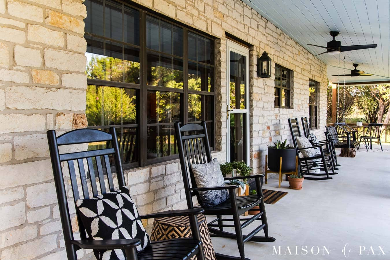black rocking chairs with black and white throw pillows | Maison de Pax