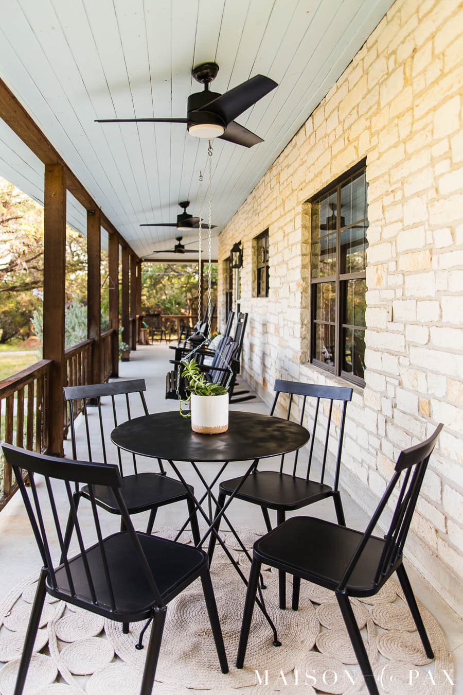 austin stone front porch with haint blue ceiling and black outdoor fans | Maison de Pax