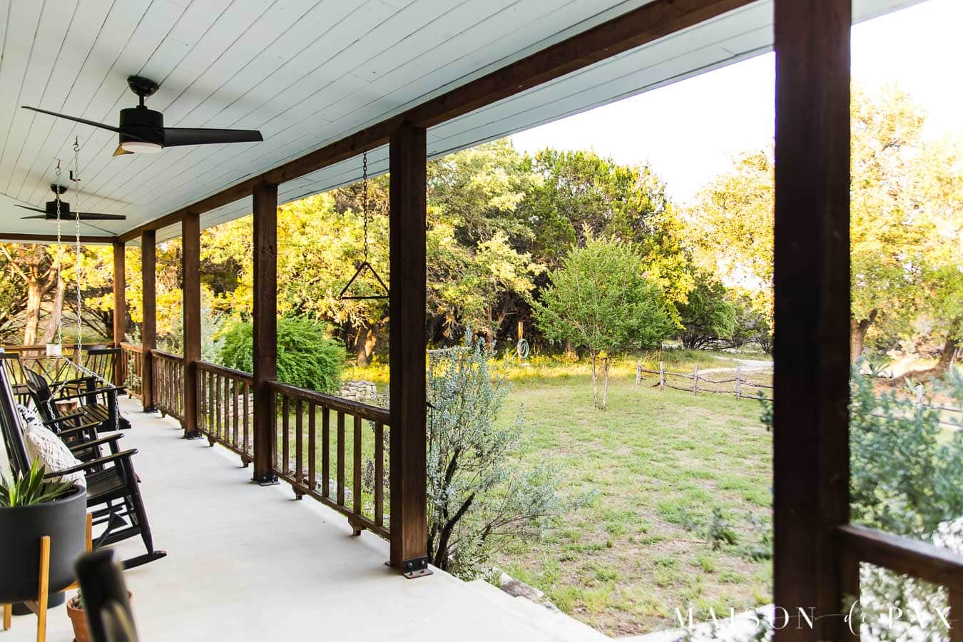 cedar railing and haint blue porch ceiling overlooking farm | Maison de Pax