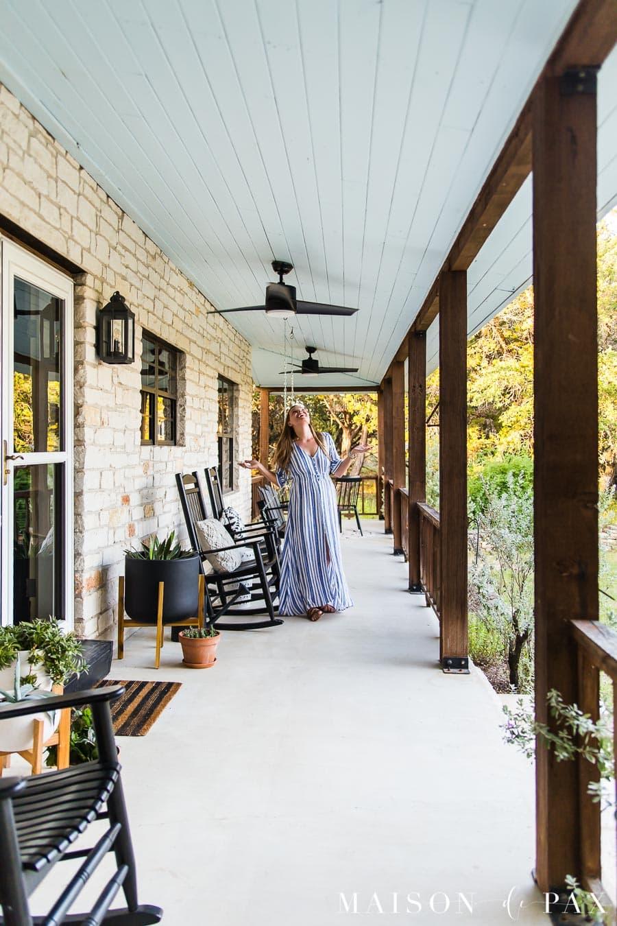 woman enjoying outdoor fans on front porch | Maison de Pax