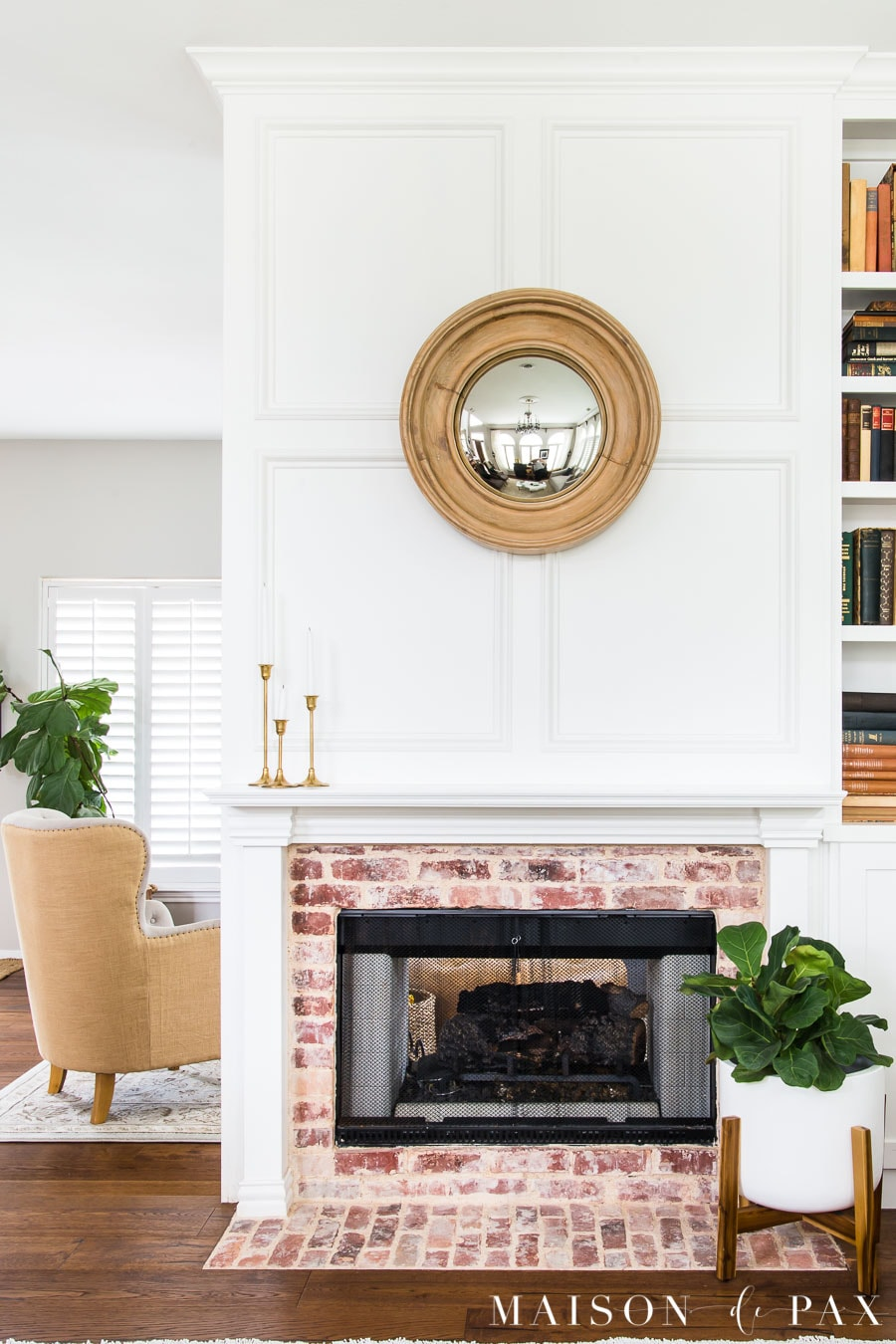 fiddle leaf fig plant in pot by fireplace and fiddle leaf fig tree beyond | Maison de Pax