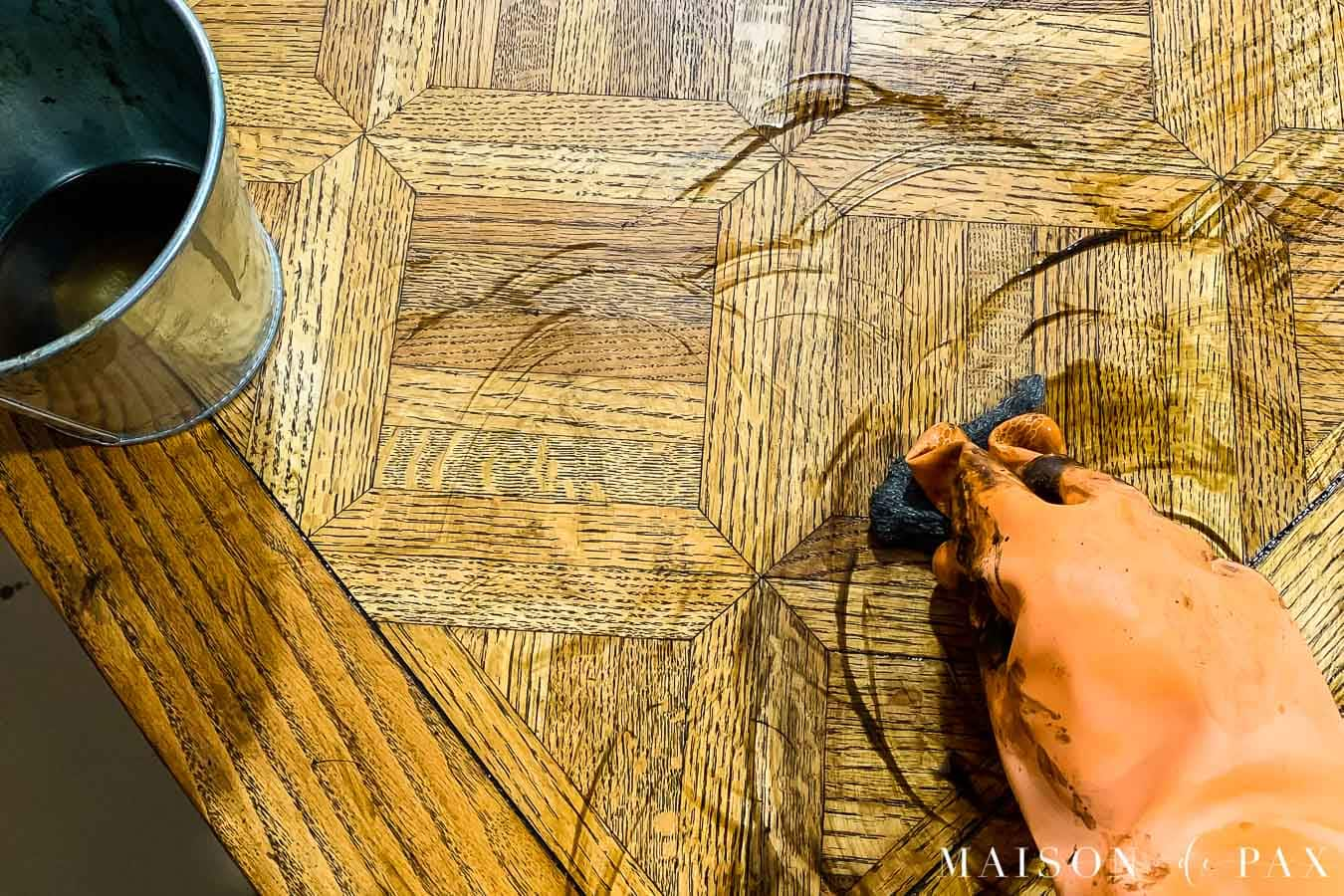 applying chemical stripper to remove old wood stain and varnish | Maison de Pax