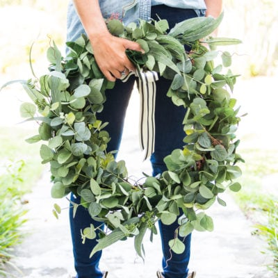woman holding large eucalyptus wreath | Maison de Pax