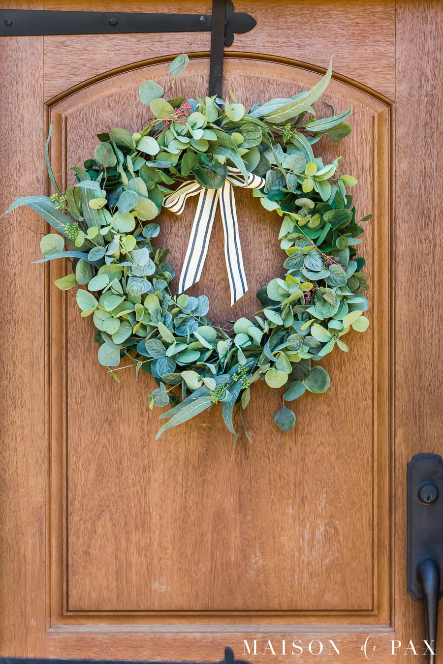 eucalyptus wreath on a wood front door | Maison de Pax