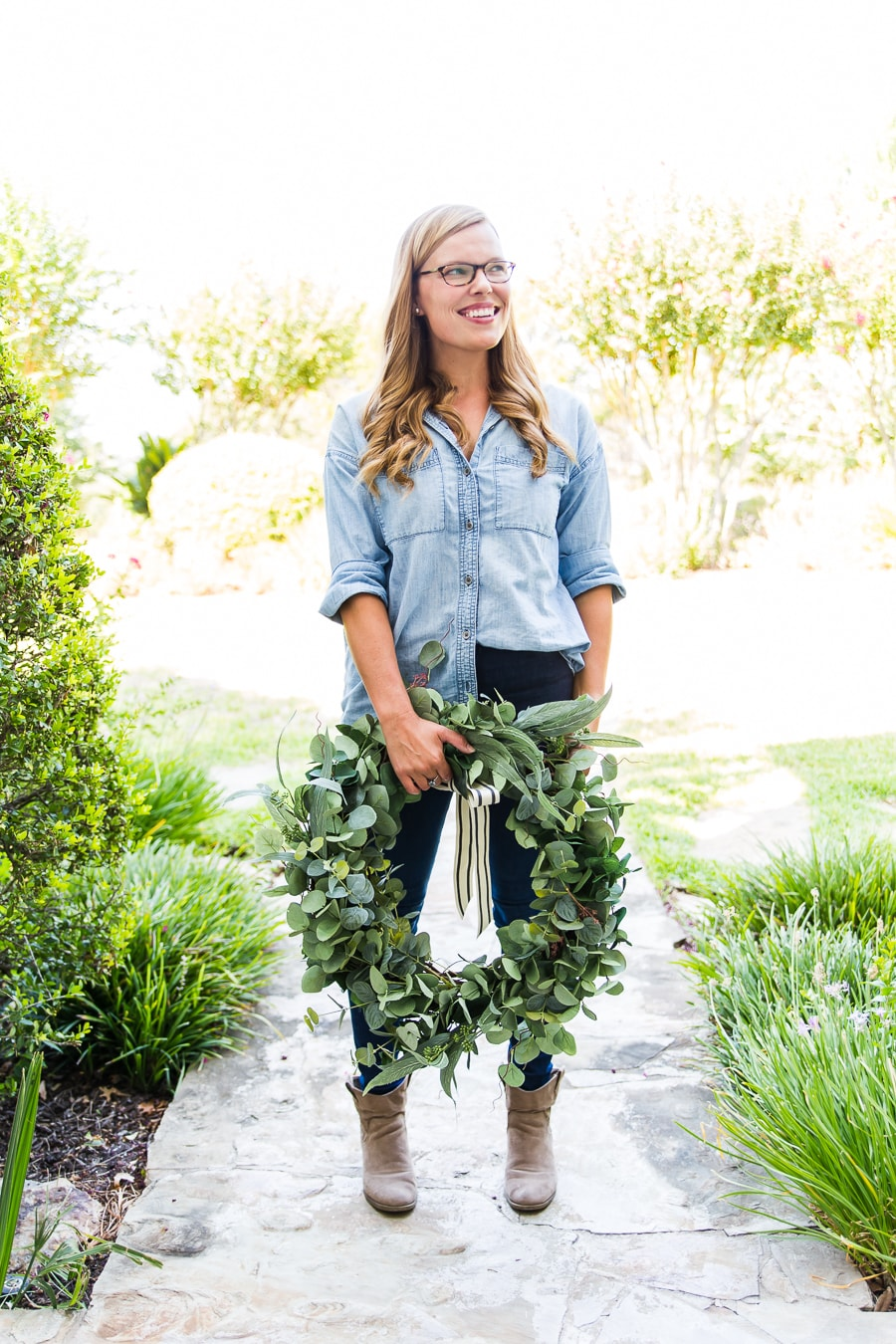 woman holding large mixed eucalyptus wreath | Maison de Pax