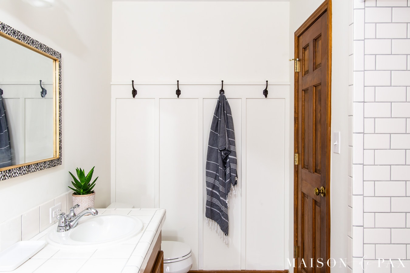 white board and batten in bathroom with wood vanity and doors | Maison de Pax