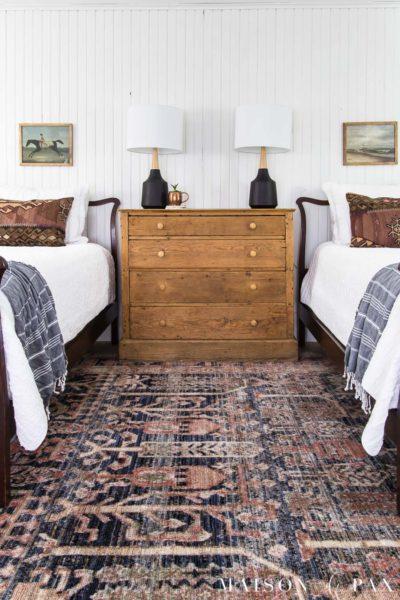 vintage rug and white twin beds | Maison de Pax