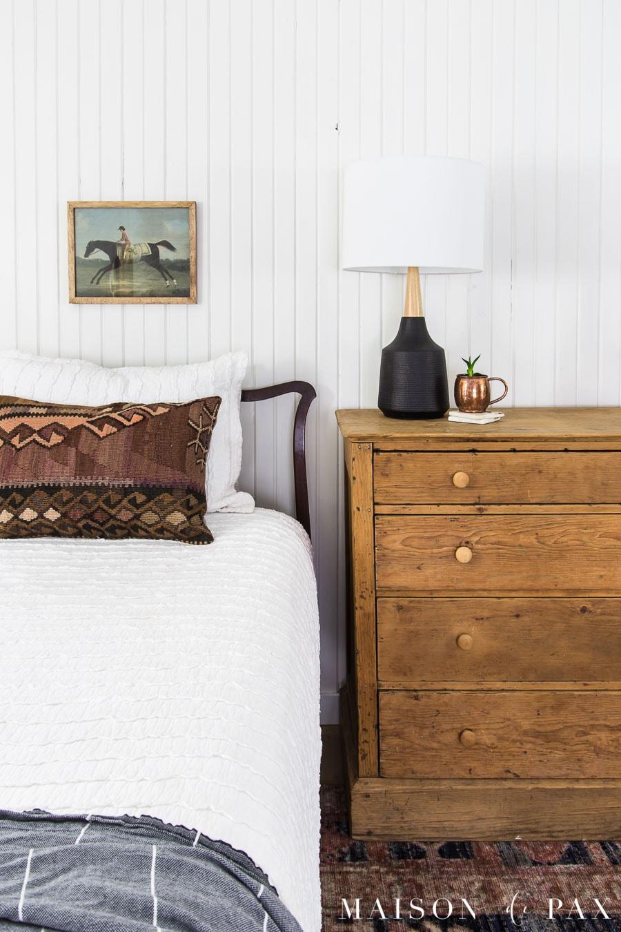 vintage art above antique bed in white farmhouse bedroom | Maison de Pax