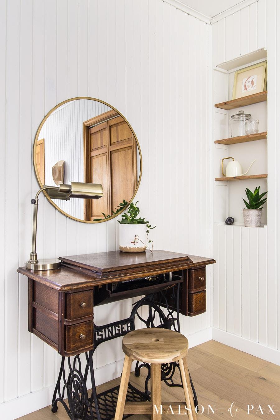 antique sewing machine with modern brass mirror above | Maison de Pax