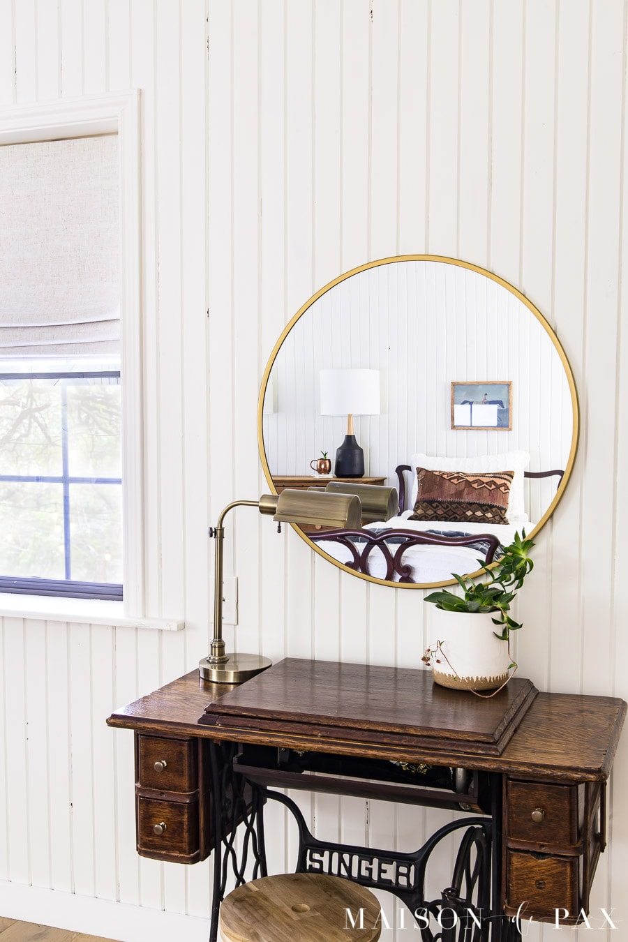 antique sewing machine used as vanity with modern brass mirror | maison de pax