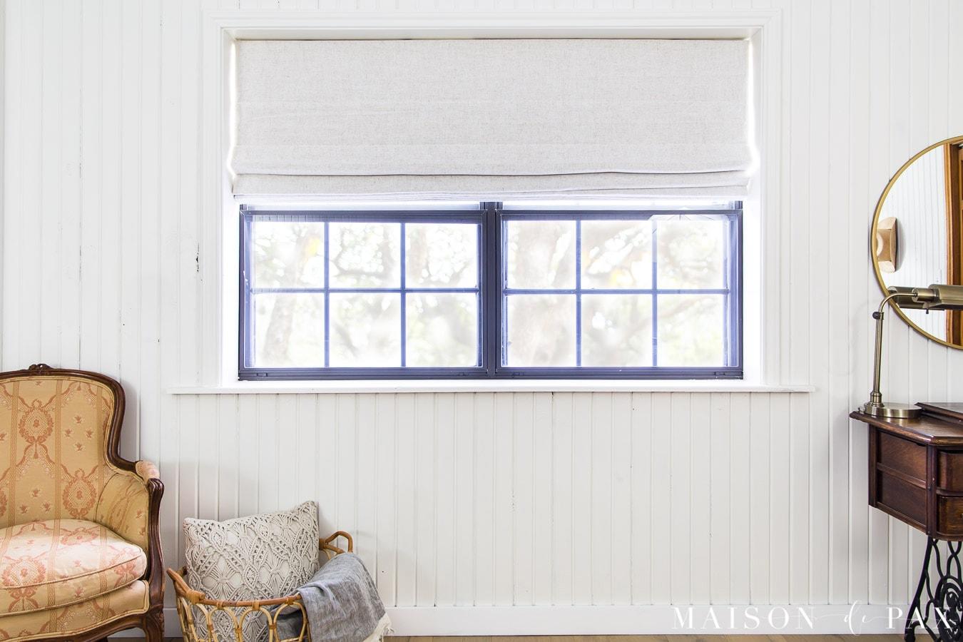 white linen roman shade with blackout liner in white farmhouse bedroom | Maison de Pax